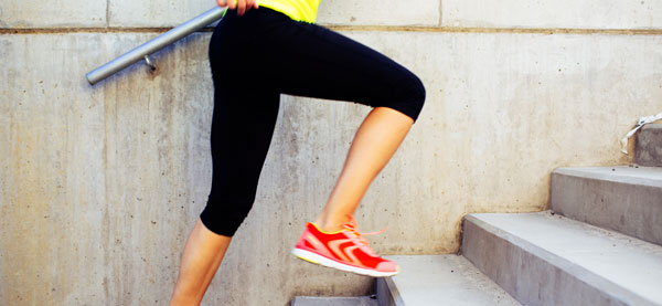 Woman running up stairs and exercising